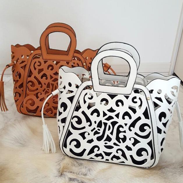 目を惹く女性はバッグが違う!魅力が溢れるカットワークバッグ